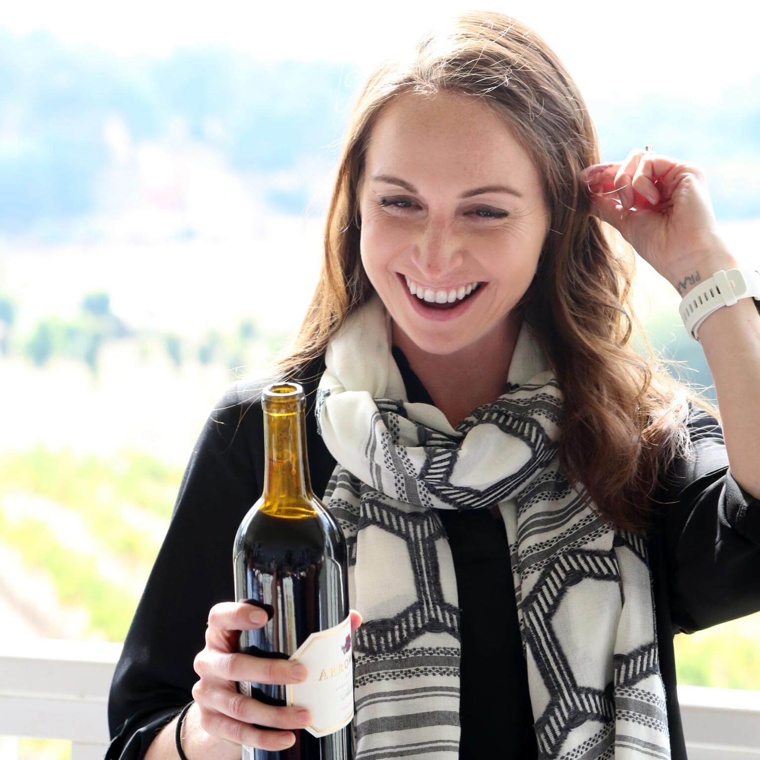 Kristina with a bottle of Arrowood wine