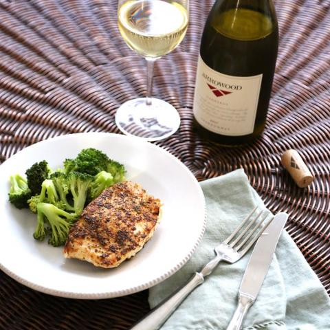 Arrowood Chardonnay next to a plate of food