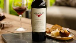 Arrowood wine on table with cheese pairing