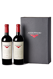 2 Bottles of red Arrowood wine next to a box