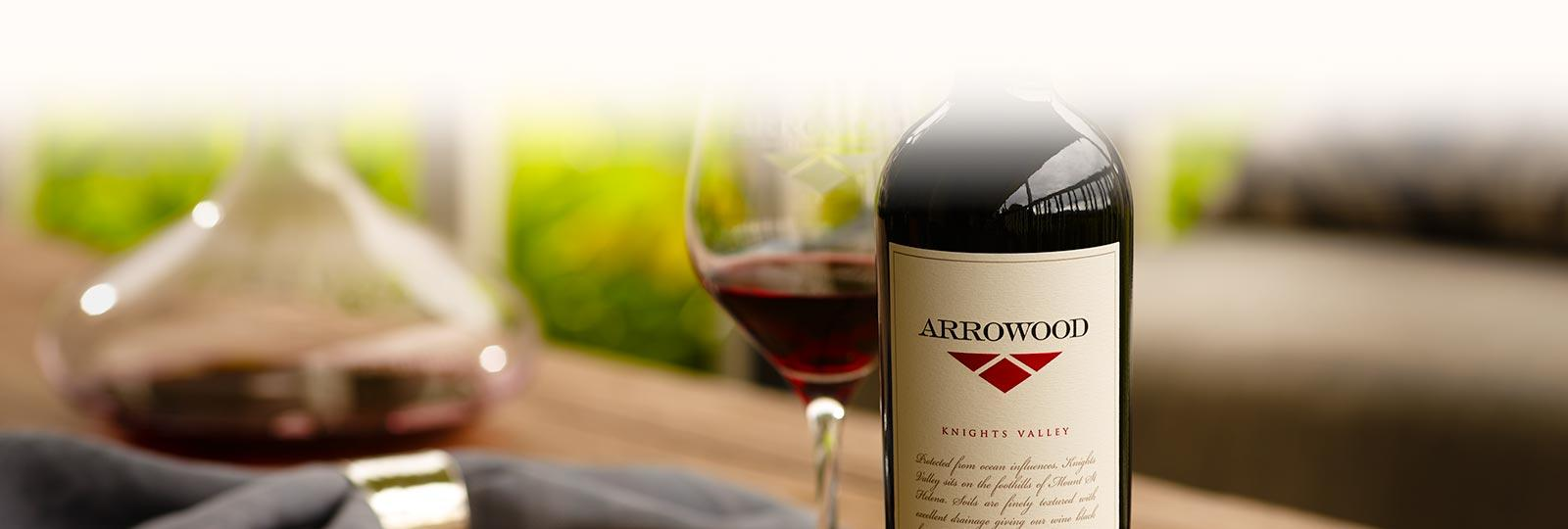 Arrowood wine on table next to a glass