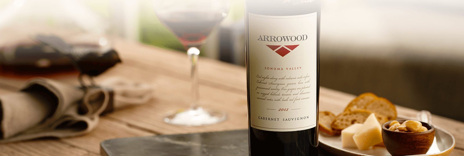 Arrowood wine on table next to cheese pairing