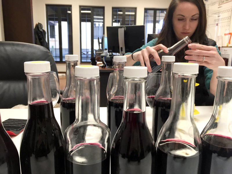 Building blends from sample bottles containing individual varieties from specific vineyard sights