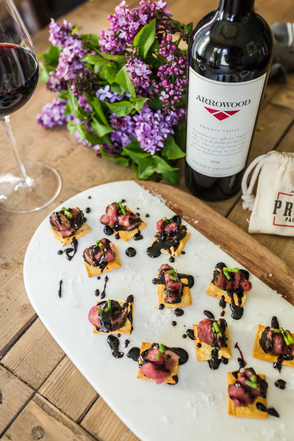 Lamb Carpaccio Crostini with Blackberry Balsamic Reduction