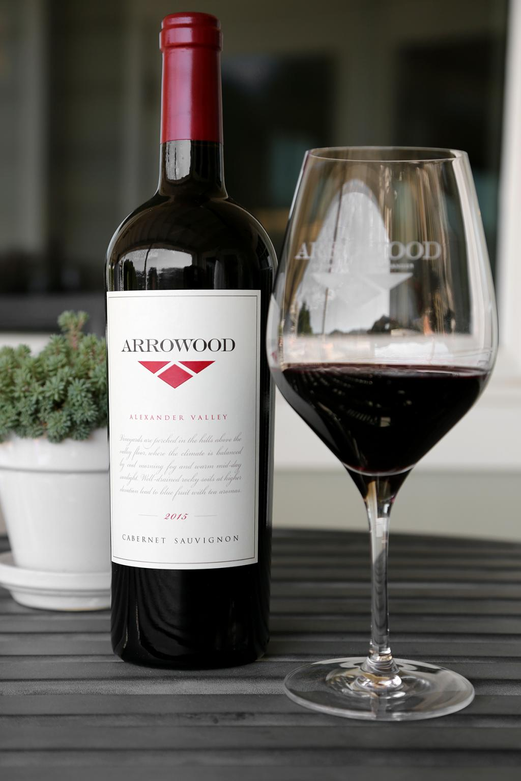 Arrowood Cabernet on table with a glass